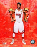 Dwyane Wade with his two NBA Championship Trophies Game 5 of the 2012 NBA Finals Photo