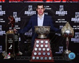 Evgeni Malkin with the 2012 Ted Lindsay Award, the Art Ross Trophy and the Hart Trophy Photo