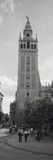 Group of People Walking Near a Church, La Giralda, Seville Cathedral, Seville, Seville Province,... Photographic Print by  Panoramic Images