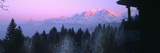 Trees with Snow Covered Mountains at Sunset in Winter, Combloux, Mont Blanc Massif, Haute-Savoie... Photographic Print by  Panoramic Images