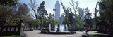 People in a Park with Skyscraper in the Background, Alameda Park, Latin America Tower, Mexico Ci... Photographic Print by  Panoramic Images