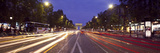Traffic on a Road with the Arc De Triomphe in the Background, Avenue Des Champs-Elysees, Paris, ... Photographic Print by  Panoramic Images