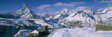 Group of People Skiing Near a Mountain, Matterhorn, Switzerland Photographic Print by  Panoramic Images