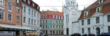 Church with Buildings Along a Street, Our Lady of Sorrows Church, Old Town, Riga, Latvia Photographic Print by  Panoramic Images