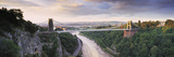 Bridge across a River at Sunset, Clifton Suspension Bridge, Avon Gorge, Avon River, Bristol, Eng... Lámina fotográfica por Panoramic Images,