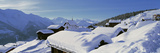Snow Covered Chapel and Chalets Swiss Alps Switzerland Fotografisk tryk af Panoramic Images