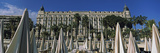 Beach Umbrellas on the Beach with Carlton Hotel in the Background, Cannes, Alpes-Maritimes, Prov... Photographic Print by  Panoramic Images