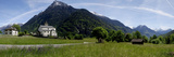 Field with a Mountain Range in the Background, Blenio Valley, Ticino, Switzerland Photographic Print by Panoramic Images