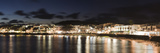 Reflection of Buildings in Water, Playa Blanca, Lanzarote, Canary Islands, Spain Photographic Print by  Panoramic Images