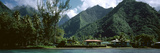 Mountains and Buildings at the Coast, Tahiti, Society Islands, French Polynesia Photographic Print by  Panoramic Images