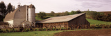 Old Barn with a Fence Made of Wheels, Palouse, Whitman County, Washington State, USA Photographic Print by  Panoramic Images