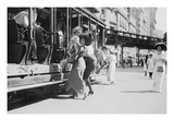 Woman Lifts Child Off of an Open Sided Trolley Car on New York's Broadway Prints