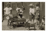 Children Load Stones in Wagon with Shovel Prints by  Tarbox