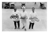 Three Chefs Stand on Steps and Hold Up Thanksgiving Platters of Pies, Apples and Turkey Prints