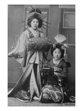Two Young Beautiful Japanese Geishas Accoutered in the Ceremonial Costumes and Hairstyles Print