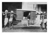 Four Indian Porters Carry a Westerner in a Palanquin or Sedan Chair Prints