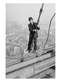 Cameraman in Suit Holds onto Cable as He Walks Unharnessed over a Skyscraper's Steel Girders Posters
