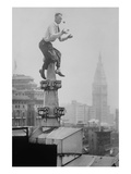 Reynolds Juggles Balls on the Pinnacle of a Roof High Above New York City Art