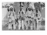Four Native American Chiefs in Traditional Clothing and Feathered Bonnet Photo