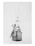 Balloon Jump by a Parachutist Hanging from a Basket Suspended by it But Out of the Image. Posters