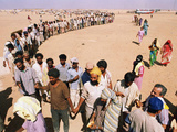 Kuwait Refugees Wait for Bread 1990 Photographic Print by Jeff Widener