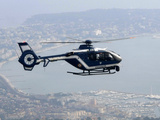 A Gendarme Helicopter is Seen Above the Bay of Cannes Photographic Print by Michel Spingler