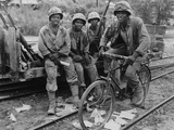 WWII U.S. Marines Take Time Out Photographic Print by  Anonymous