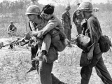 Vietnam War U.S. Aid Enemy Wounded Photographic Print by Horst Faas