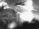 WWII U.S. Superfortress Afire Photographic Print by  Anonymous