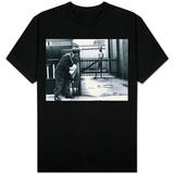 A Postman Hides Behind a Wall, Scared of a Great Dane Dog Leaning on the Fence of the House T-Shirt