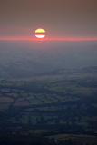 Sunset over rural Wales valley in Powys Fotoprint van Charles Bowman