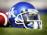 University of Kentucky - Kentucky Helmet Sits at Commonwealth Stadium Photographic Print