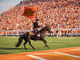 Oklahoma State University - The Cowboy Enters Boone Pickens Stadium Fotografisk tryk