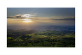 Wales landscape with setting sun Photographic Print by Charles Bowman