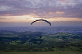 Paraglider takes off over Wales landscape Premium Giclee Print by Charles Bowman