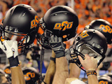 Oklahoma State University - OSU Helmets Held High Photographic Print