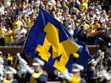 University of Michigan - Michigan Flag Flies on Game Day Photographic Print