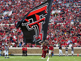 Texas Tech University - Red Raider Cheerleaders and Flag Fotografisk tryk af Michael Strong