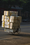 Cyclist in China with huge load of boxes Photographic Print by Charles Bowman