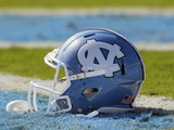 University of North Carolina - UNC Helmet Sits at Kenan Stadium Photographic Print