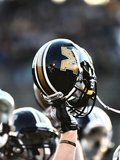 University of Missouri - Missouri Football Helmet Held High Print by Steve Malinowski