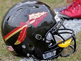 Florida State University - New FSU Football Helmet on the Field Photographic Print by Mike Olivella