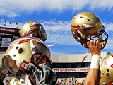 Florida State University - Football Helmets Held High Photographic Print by Mike Olivella