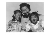 Mrs. Nakamura and 2 Daughters (Joyce Yuki and Louise Tami Poster by Ansel Adams