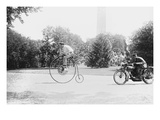 Motorcycle Cop Chases a Penny Farthing Velocipede Down a DC Street with Washington Monument in Back Posters
