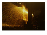 Welder's Torch Has Sparks Fly on Locomotive Factory Floor Print