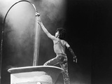 Prince,E Simulates a Shower During Concert Performance, 1984 Photographic Print by Michael Cheers