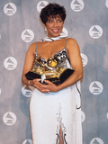 Natalie Cole Cradles Her Statues, 34th Annual Grammy Awards, February 25, 1992 Photographic Print by Frederick Watkins