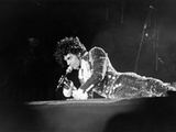 Prince, Lying on Stage During His Purple Rain Tour, 1984 Stampa fotografica di Michael Cheers