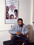 Filmmaker Spike Lee, Seated in Front of a Poster of His Film 'She's Gotta Have It', 1986 Photographic Print by Vandell Cobb